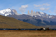 Horses stand near  Laguna Azul on a typically windy day, The Torres del Paine are in the backgrouns Torres del Paine National Park,  Republic of Chile 19Feb13