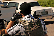 Undercover and law enforcement officers from a multi-task force conduct a drug bust in Tucson, Arizona, USA.