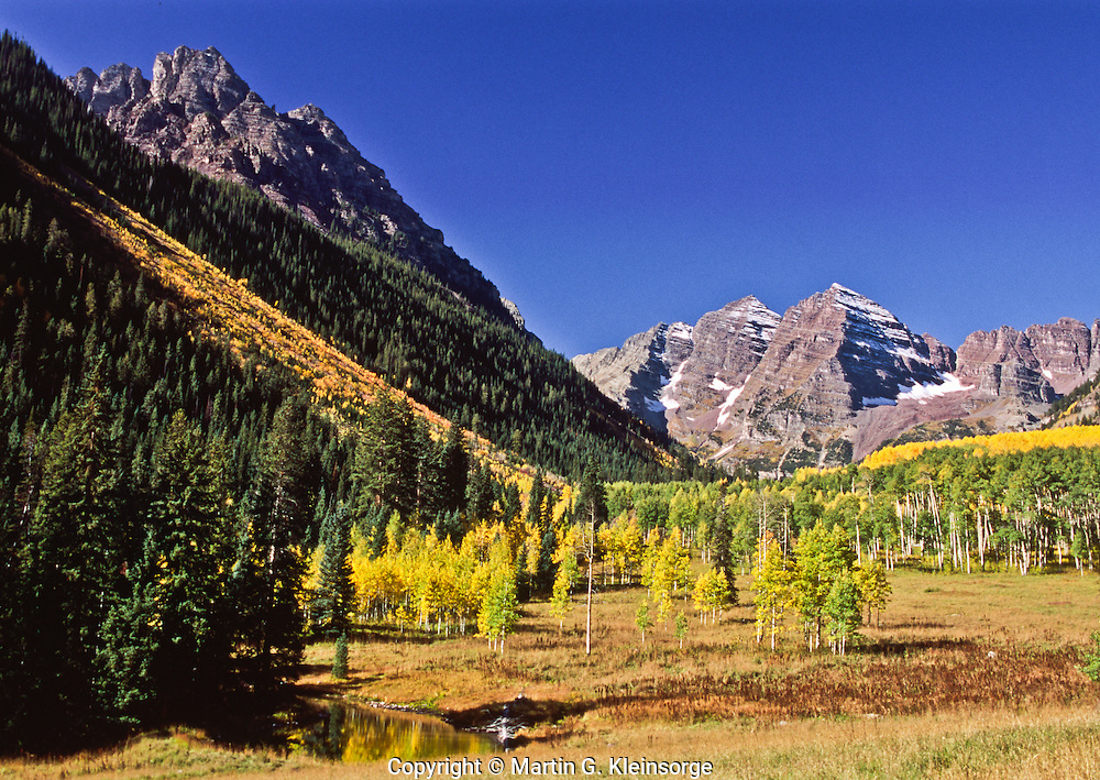 Maroon Bells with 14,018 ft. Pyramid Peak on the left.  Elk Mountains, Colorado.