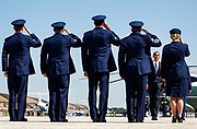 U.S. President Barack Obama (2nd R) receives a salute as he boards Air Force One at Andrews Air Force Base near Washington, June 18, 2010. REUTERS/Jim Young