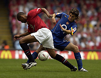 Picture: Henry Browne.Digitalsport<br /> Date: 08/08/2004.<br /> Arsenal v Manchester United FA Community Shield.<br /> <br /> David Bellion of United is challenges by Cese Fabregas of Arsenal.