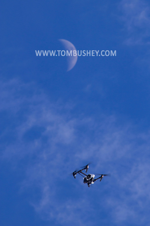 Montgomery, New York - A DJI Inspire 1 quadcopter flies over Benedict Farm with the moon in the background on Jan. 25, 2015.
