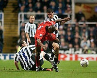Photo. Glyn Thomas, Digitalsport<br /> Newcastle United v Fulham. FA Barclaycard Premiership. <br /> St James's Park, Newcastle. 19/01/2004.<br /> Newcastle's Andy O'Brien (L) slides in to tackle Luis Boa Morte (C) while Aaron Hughes looks on.