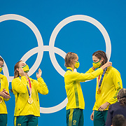 TOKYO, JAPAN - AUGUST 1:  The Australian 4x 100 Medley relay team of Kaylee McKeown, Chelsea Hodges, Emma McKeon and Cate Campbell on the podium after their gold medal swim during the Swimming Finals nat the Tokyo Aquatic Centre at the Tokyo 2020 Summer Olympic Games on August 1, 2021 in Tokyo, Japan. (Photo by Tim Clayton/Corbis via Getty Images)
