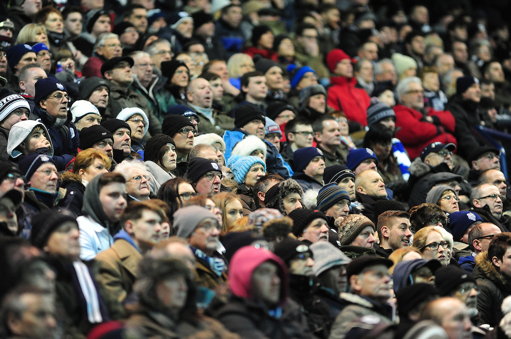 Preston North End fans during the second half <br /> <br /> Photographer Chris Vaughan/CameraSport<br /> <br /> Football - The Football League Sky Bet League One - Preston North End v Walsall - Tuesday 24th February 2015 - Deepdale - Preston<br /> <br /> © CameraSport - 43 Linden Ave. Countesthorpe. Leicester. England. LE8 5PG - Tel: +44 (0) 116 277 4147 - admin@camerasport.com - www.camerasport.com