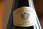 Closeup close-up of a red wine bottle label Maison Louis Jadot 2002 with the Baccus Bacchus symbol of the producer, Maison Louis Jadot, Beaune Côte Cote d Or Bourgogne Burgundy Burgundian France French Europe European