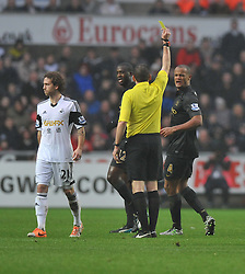 Manchester City's Vincent Kompany gets booked for a tackle. - Photo mandatory by-line: Alex James/JMP - Tel: Mobile: 07966 386802 01/01/2014 - SPORT - FOOTBALL - Liberty Stadium - Swansea - Swansea City v Manchester City - Barclays Premier League