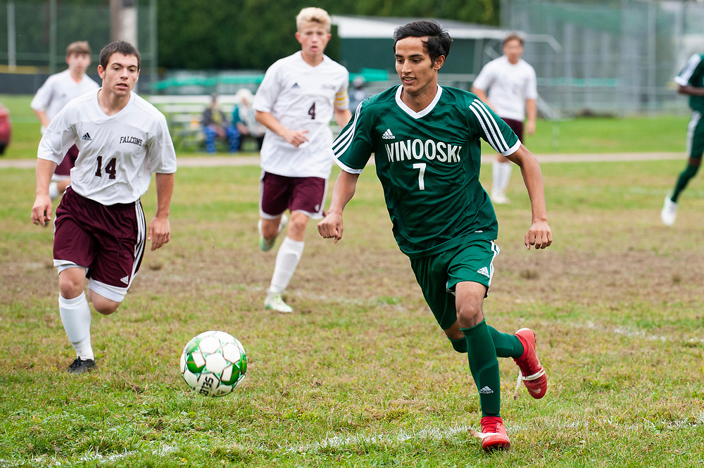 Winooski's Lek Nath Luitel (7) plays the ball during the boys soccer game between the Richard Eagles and the Winooski Spartans at Winooski High School on Saturday afternoon September 28, 2019 in Winooski, Vermont. (BRIAN JENKINS/for the FREE PRESS)