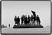 """Figurengruppe by Fritz Cremer at the Buchewald Memorial.<br />Buchenwald; literallybeech forest) was aNazi concentration campestablished onEttersberghill nearWeimar,Germany, in July 1937. On the main gate, the mottoJedem das Seine(English: """"To each his own""""), was inscribed. The SS interpreted this to mean the """"master race"""" had a right to humiliate and destroy others<br />It was one of the first and the largest of the concentration camps within Germany's1937 borders. Many actual or suspected communists were among the first internees.<br />Prisoners came from all over Europe and the Soviet Union—Jews,Polesand otherSlavs, the mentally ill and physically disabled, political prisoners,Romani people,Freemasons, and prisoners of war. There were also ordinary criminals and sexual """"deviants"""". All prisoners worked primarily as forced labour in local armaments factories. The insufficient food and poor conditions, as well as deliberate executions, led to 56,545 deaths at Buchenwald of the 280,000 prisoners who passed through the camp and its 139 subcamps.The camp gained notoriety when it was liberated by the United States Army in April 1945; Allied commanderDwight D. Eisenhowervisited one of itssubcamps.<br />From August 1945 to March 1950, the camp was used by the Soviet occupation authorities as an internment camp,NKVD special camp Nr. 2, where 28,455 prisoners were held and 7,113 of whom died. Today the remains of Buchenwald serve as a memorial and permanent exhibition and museum."""