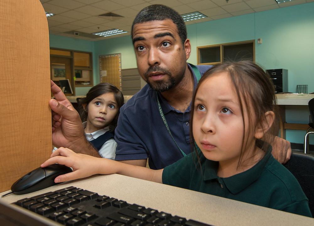Kindergarteners work on coding problems at Briargrove elementary School, December 5, 2014.