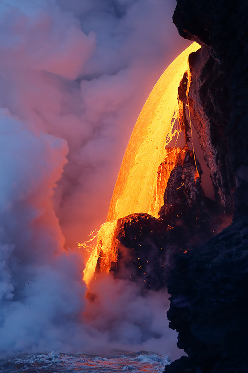 The firehose at the Kamokuna ocean entry, is a 50-60 foot stream of lava shooting directly into the sea, creating spectacular littoral explosions, sending shards of molten lava, or ejecta, more than 100 feet into the air.