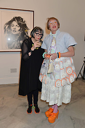 GRAYSON PERRY and his wife PHILIPPA PERRY at a private view of photographs by David Bailey entitled 'Bailey's Stardust' at the National Portrait Gallery, St.Martin's Place, London on 3rd February 2014.