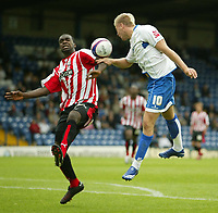 Photo: Aidan Ellis.<br /> Bury FC v Brentford. Coca Cola League 2. 01/09/2007.<br /> Bury's Andy bishop (R) challenges Brentford's Kevin O'Connor