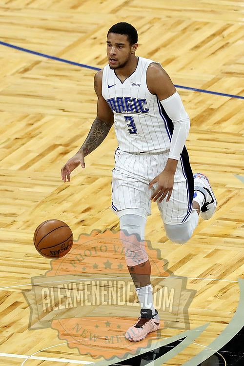 ORLANDO, FL - FEBRUARY 23:  Chuma Okeke #3 of the Orlando Magic controls the ball against the Detroit Pistons at Amway Center on February 23, 2021 in Orlando, Florida. NOTE TO USER: User expressly acknowledges and agrees that, by downloading and or using this photograph, User is consenting to the terms and conditions of the Getty Images License Agreement. (Photo by Alex Menendez/Getty Images)*** Local Caption *** Chuma Okeke