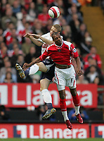 Photo: Lee Earle.<br /> Charlton Athletic v Tottenham Hotspur. The Barclays Premiership. 07/05/2007.Charlton's Marcus Bent (R) clashes with Michael Dawson.