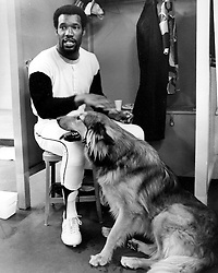 """San Francisco Giants outfielder Bobby Bonds in the locker room with his dog """"Ringo"""". .(1974 photo by Ron Riesterer)"""