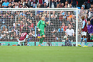 Aston Villa players look dejected after Aly Cissokho (23) deflects a Kieran Gibbs strike into his own goal to make the score 0-3. Barclays Premier league match, Aston Villa v Arsenal at Villa Park in Birmingham on Saturday 20th Sept 2014<br /> pic by Mark Hawkins, Andrew Orchard sports photography.