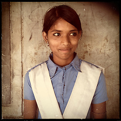 iPhone portrait of Suman Bairwa, 14, who refused her marriage after attending the Pehchan Project in Rajasthan, India, April 3, 2013. Under Indian law, children younger than 18 cannot marry. Yet in a number of India's states, at least half of all girls are married before they turn 18, according to statistics gathered in 2012 by the United Nations Population Fund (UNFPA). However, young girls in the Indian state of Rajasthan—and even a few boys—are getting some help in combatting child marriage. In villages throughout Tonk, Jaipur and Banswara districts, the Center for Unfolding Learning Potential, or CULP, uses its Pehchan Project to reach out to girls, generally between the ages of 9 and 14, who either left school early or never went at all. The education and confidence-building CULP offers have empowered young people to refuse forced marriages in favor of continuing their studies, and the nongovernmental organization has provided them with resources and advocates in their fight.
