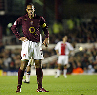 Photo: Chris Ratcliffe.<br />Arsenal v Ajax. UEFA Champions League. 07/12/2005.<br />Thierry Henry ponders his penalty miss in the rain at Highbury