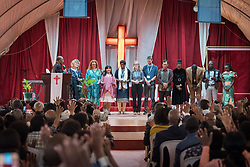 27 October 2019, Addis Ababa, Ethiopia: Sunday service at the Finfinne Oromo Mekane Yesus Congregation of the Ethiopian Evangelical Church Mekane Yesus. In a context where congregations did not use to be allowed to hold their services in any language but Amharic, the congregation today is one of some 60 Oromo speaking Mekane Yesus congregations in Addis Ababa. Here, the congregation blesses a group of international visitors from the Lutheran World Federation.