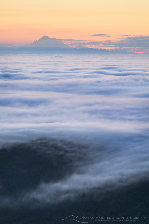 Fog over Puget Sound At sunrise seen from Olympic Mountains. Mount Baker is in the distance