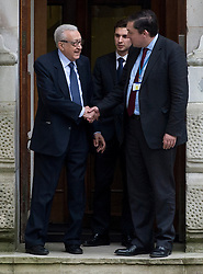 """© Licensed to London News Pictures. 06/03/2013. Westminster, UK. Special Envoy for Syria, Lakhdar Brahimi (left), shakes hands with Foreign Office staff as he leaves the UK Foreign Office, this afternoon 6th March 2013. William Hague, The Foreign Secretary today announced the UK will supply """"non-lethal"""" protective equipment to Syria's opposition, including armoured vehicles and body armour. Photo credit :Ben Cawthra/LNP"""