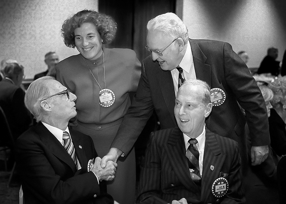 Irwin, left, and Bob Goodman, also seated, greet Leslie Ann Howard and Jon Udell at a Downtown Madison Rotary Club meeting in Nov. 15, 1998. (Photo © Andy Manis)