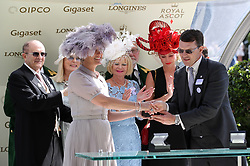 Sophie Countess of Wessex presents winning trainer Aiden O'Brien with the an award for Magic Wand winning the Ribblesdale Stakes during day three of Royal Ascot at Ascot Racecourse..