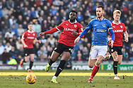 Barnsley Forward, Mamadou Thiam (26) Portsmouth Midfielder, Tom Naylor (7) during the EFL Sky Bet League 1 match between Portsmouth and Barnsley at Fratton Park, Portsmouth, England on 23 February 2019.
