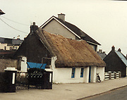 Photographed in 1988, A rare sight in Dublin, a thatched cottage. Do you know its location. If you do why not let us know and we will add your information<br />