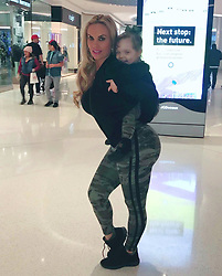 """Coco Austin releases a photo on Twitter with the following caption: """"""""Mall time!!! <br /> Chanel never lets me take a pic without her..Lol<br /> Sports gear-@FashionNova"""""""". Photo Credit: Twitter *** No USA Distribution *** For Editorial Use Only *** Not to be Published in Books or Photo Books ***  Please note: Fees charged by the agency are for the agency's services only, and do not, nor are they intended to, convey to the user any ownership of Copyright or License in the material. The agency does not claim any ownership including but not limited to Copyright or License in the attached material. By publishing this material you expressly agree to indemnify and to hold the agency and its directors, shareholders and employees harmless from any loss, claims, damages, demands, expenses (including legal fees), or any causes of action or allegation against the agency arising out of or connected in any way with publication of the material."""