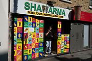 Colourful kebab shop on Brick Lane on 24th June 2020 in London, England, United Kingdom. This fast food takeaway restaurant sells Shawarma kebabs.