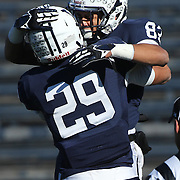 Robert Clemons III, (right), Yale, is congratulated by teammate Grant Wallace after scoring a touchdown during the Yale Vs Princeton, Ivy League College Football match at Yale Bowl, New Haven, Connecticut, USA. 15th November 2014. Photo Tim Clayton