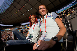 Nina Kolaric and Sonja Roman of Slovenia on a tribune at the 2009 IAAF Athletics World Championships on August 15, 2009 in Berlin, Germany. (Photo by Vid Ponikvar / Sportida)