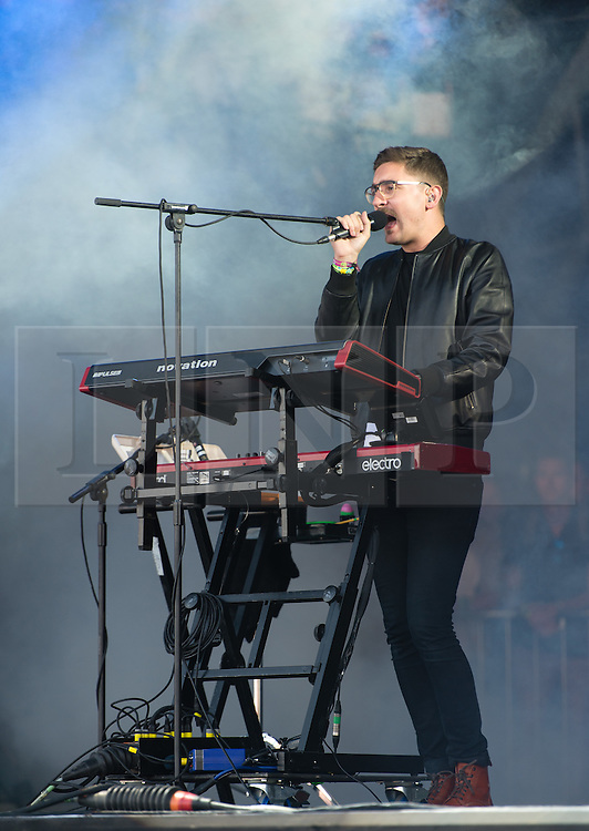 © Licensed to London News Pictures. 28/06/2015. Pilton, UK. Alt J performing at Glastonbury Festival 2015 on Sunday Day 5 of the festival on the The Pyramid Stage stage.  This years headline acts include Kanye West, The Who and Florence and the Machine, the latter being upgraded in the bill to replace original headline act Foo Fighters.  Photo credit: Richard Isaac/LNP