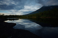 Mount Gamalama volcano.  Active volcano on Ternate Island reflecting in a pond.