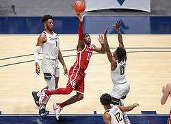 Feb 13, 2021; Morgantown, West Virginia, USA; Oklahoma Sooners guard De'Vion Harmon (11) shoots over West Virginia Mountaineers guard Kedrian Johnson (0) during the first half at WVU Coliseum. Mandatory Credit: Ben Queen-USA TODAY Sports
