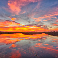 South Florida sunset photography from nature landscape photographer Juergen Roth showing a stunning sunset across Loxahatchee National Wildlife Refuge located west of Boynton Beach in Palm Beach County, FL. Arthur R. Marshall Loxahatchee National Wildlife Refuge is an amazing area for viewing wildlife and photography in Florida. <br />