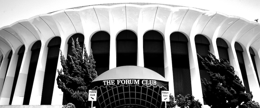 18 April 2006: Black and White panoramic shot of the Exterior view during the day of Sports Landmark Los Angeles Great Western Forum in Inglewood, California. 3900 West Manchester Boulevard, CA 90305. The Forum is currently owned by Forum Enterprises, Inc and managed by SMG. This arena was built in 1967 by Jack Kent Cooke, funded by Dr. Jerry Buss and Ogden Management, privately financed at a cost of $16 Million Dollars US.  It was the home to professional sports teams like the NHL Los Angeles Kings from 1967-1999, The NBA Los Angeles Lakers 1967-1999 and the WNBA Los Angeles Sparks as well as special events and concerts.  Located less than three miles from LAX airport and seats 17,505 fans inside the circular arena.