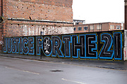 Justice for the 21 campaign street art graffiti mural for the victims of the Birmingham pub bombings on 6th January 2021 in Birmingham, United Kingdom. The Birmingham pub bombings were carried out on 21 November 1974, when bombs exploded in two public houses in Birmingham, England, killing 21 people and injuring 182 others.