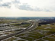 Nederland, Zuid-Holland, Gemeente Alkemade, 20-02-2012; infrastructuur bundel bestaande uit autosnelweg A4 en het hogesnelheidspoor HSL-Zuid (onder) doorkruist het veenweidelandschap tussen Roelofarendsveen en Rijpwetering. Onder in beeld de verdiepte kruising HSL- A4, met viaduct van de hogesnelheidslijn..Infrastructure bundle consisting of A4 motorway and the high-speed (bottom) crosses the bog meadows area between Roelofarendsveen and Rijpwetering..luchtfoto (toeslag), aerial photo (additional fee required).copyright foto/photo Siebe Swart