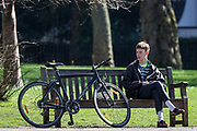 A Londoner is seen enjoying the sunshine beside his bicycle at the St James's Park in London, Monday, March 23, 2020. <br /> To help prohibit the spread of Coronavirus, the British Government imposed further restrictions on Monday to enforce public adherence to their advice for social distancing. (Photo/Vudi Xhymshiti)