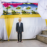 A makeshift photo studio is set up outside the home to take family portraits before a wedding in Ahmedabad, Gujarat 2012