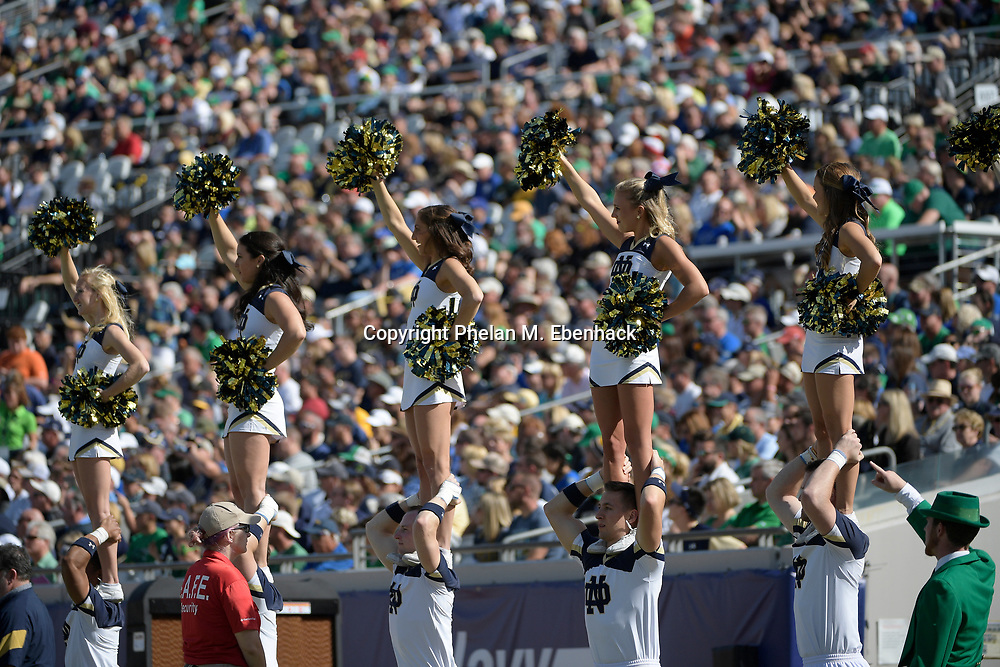 The Notre Dame cheerleaders perform during the first half of an NCAA college football game against Navy in Jacksonville, Fla., Saturday, Nov. 5, 2016. (Photo by Phelan M. Ebenhack)