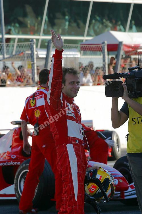 Test driver Luca Badoer waves to the fans at the 2006 Ferrari Finals at Monza on October 29. Photo: Grand Prix Photo