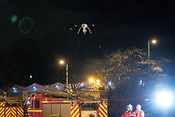 © Licensed to London News Pictures . 25/12/2017. Manchester, UK. A drone is used to examine the scene . At least eight fire engines, teams of firefighters, police and ambulance crews are responding to a fire, which was first reported just after 1am on Christmas day morning, on an industrial unit in Cheetham Hill , off Cheetham Hill Road, in Salford on the edge of Manchester City Centre . Photo credit: Joel Goodman/LNP