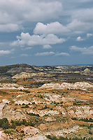 Painted Canyon Panorama. Theodore Roosevelt National Park. Composite of 9 of 9 images taken with a Nikon D3 camera and 85 mm f/2.8 PC-E lens (ISO 200, 85 mm, f/16, 1/40 sec). Raw images processed with Capture One Pro (BM-02 Teton Style). Composite generated with  AutoPano Giga Pro.
