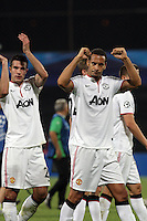 Robin van Persie (L) and Rio Ferdinand (R) of Manchester United celebrate after the UEFA Champions League, Group H, soccer match against CFR Cluj, at Dr. Constantin Radulescu Stadium in Cluj-Napoca, Romania, 2 October 2012.