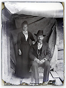 man and woman inside natural light improvised outdoors studio vintage 1900s glass plate