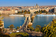 View across the Danube to Pest from The Buda Castle Hill, with the Szecheni Chain Bridge ( Lanchid ). Budapest, Hungary .<br /> <br /> Visit our HUNGARY HISTORIC PLACES PHOTO COLLECTIONS for more photos to download or buy as wall art prints https://funkystock.photoshelter.com/gallery-collection/Pictures-Images-of-Hungary-Photos-of-Hungarian-Historic-Landmark-Sites/C0000Te8AnPgxjRg